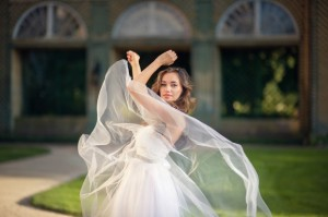 bride-dancing-in-front-of-building_1304-4133